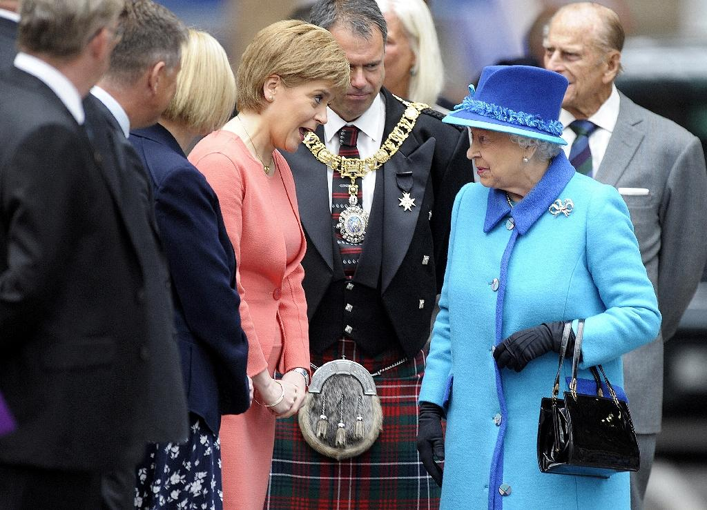 Queen Elizabeth speaks with Scottish First Minister Nicola Sturgeon as she arrives at Edinburgh's Waverley Station, on September 9, 2015