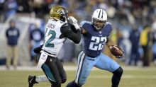 Titans clinch playoff berth with 15-10 victory over Jaguars