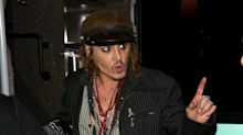 Johnny Depp stays on tour as report says his ill son is 'a lot better'