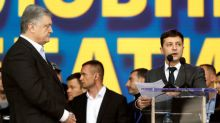 Ukrainian presidential candidates trade insults in rowdy stadium debate