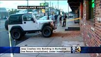 Surveillance Video: Jeep Crashes Into Building