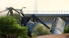 Train carrying hazardous materials derails, catches fire on bridge over Arizona lake