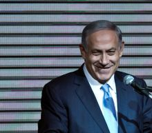 Netanyahu charged in corruption cases, deepening Israeli political disarray
