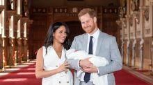 Prince Harry breaks with tradition by holding the royal baby
