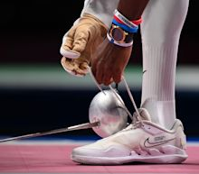 US fencer confronts teammates wearing pink masks in apparent protest of his inclusion on team