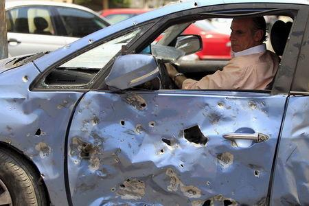 A man moves his damaged car away from the site of a car bomb attack on the convoy of Egyptian public prosecutor Hisham Barakat near his house at Heliopolis district in Cairo, Egypt, June 29, 2015. REUTERS/Mohamed Abd El Ghany