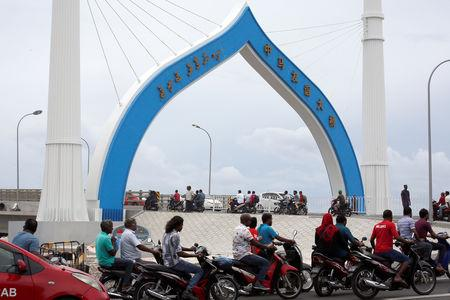 FILE PHOTO: Maldivians travel on the China-funded Sinamale bridge in Male, Maldives September 18, 2018. REUTERS/Ashwa Faheem/File Photo