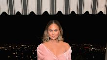 Chrissy Teigen just stepped out in the ultimate holiday dress of the season