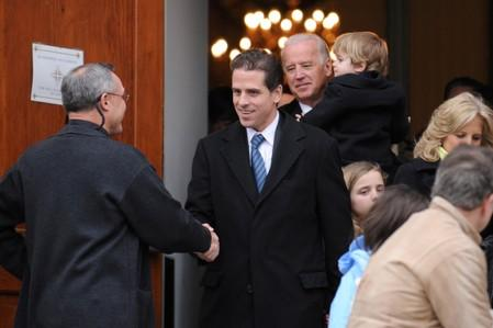 FILE PHOTO: U.S. Vice President Biden and his son Hunter Biden depart after a pre-inauguration church service in Washington