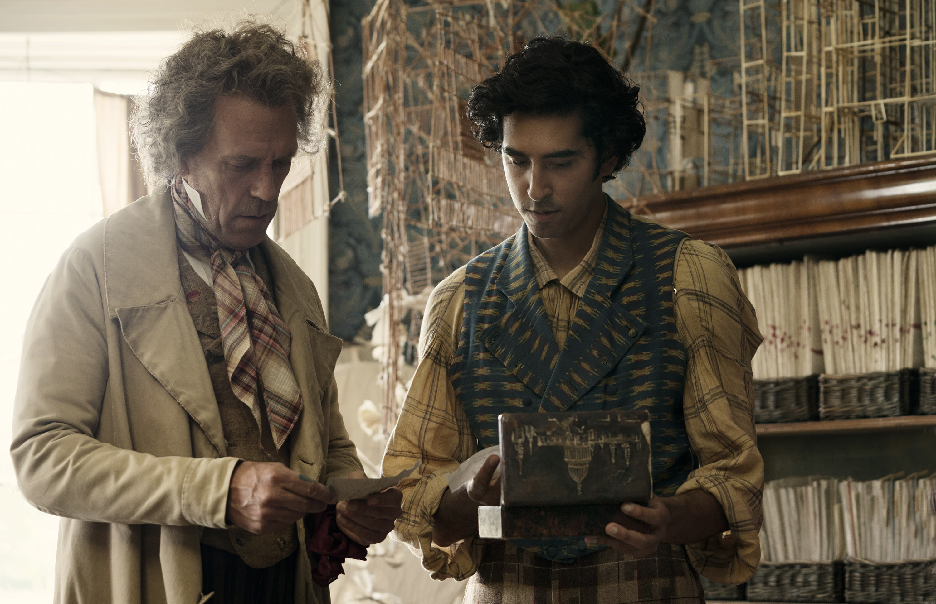 """This image released by Fox Searchlight Pictures shows Hugh Laurie, left, and Dev Patel in a scene from the film """"The Personal History of David Copperfield."""" (Dean Rogers/Fox Searchlight Pictures via AP)"""