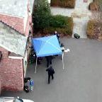 Emergency responders perform CPR outside Fotis Dulos' home