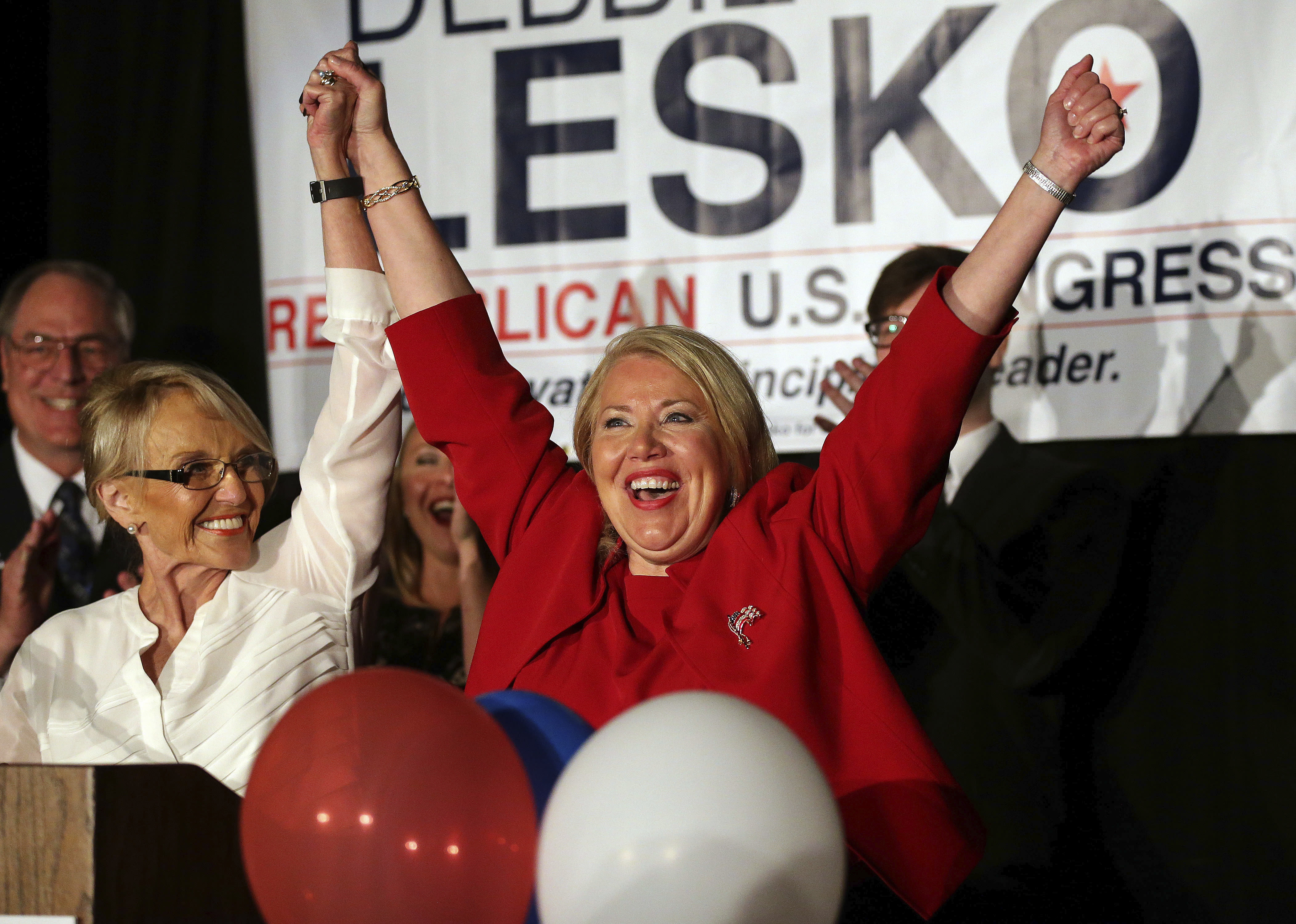 <p> Republican U.S. Congressional candidate Debbie Lesko, right, celebrates her win with former Arizona Gov. Jan Brewer at her home, Tuesday, April 24, 2018, in Peoria, Ariz. Lesko ran against Democratic candidate Hiral Tipirneni for Arizona's 8th Congressional District seat being vacated by U.S. Rep. Trent Franks, R-Arizona. (AP Photo/Matt York) </p>
