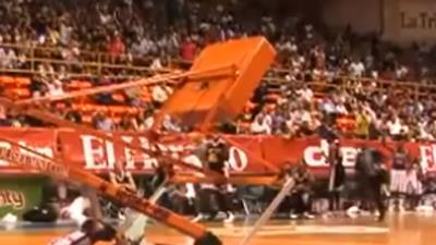 Raw: Backboard Shatters, Falls on Globetrotter