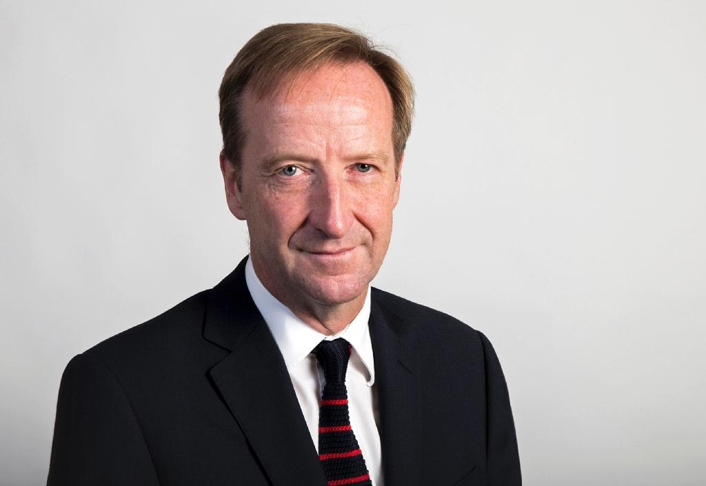 This handout image received from Britain's Foreign and Commonwealth Office shows Alex Younger, appointed Chief of the Secret Intelligence Service MI6