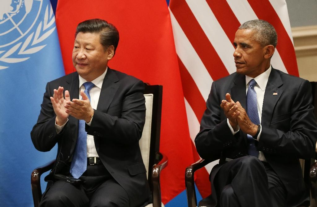 US President Barack Obama (right) and Chinese President Xi Jinping clap as UN Secretary General Ban Ki-moon delivers his speech in Hangzhou on September 3, 2016 (AFP Photo/How Hwee Young)