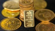 Gold slips on firmer dollar; political uncertainty supports