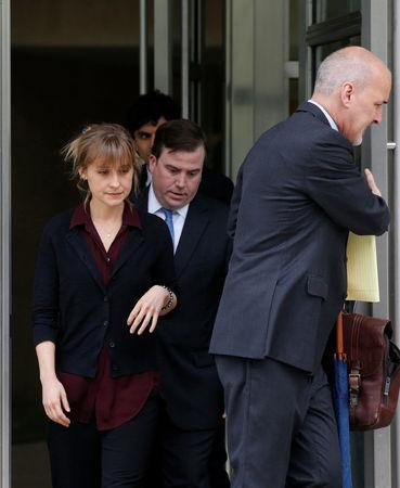 Actor Allison Mack, known for her role in the TV series 'Smallville', exits with her lawyers following a hearing on charges of sex trafficking in relation to the Albany-based organization Nxivm at United States Federal Courthouse in Brooklyn, New York, U.S., May 4, 2018. REUTERS/Brendan McDermid