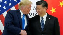Asian markets gain as U.S., China agree to go back to the negotiating table