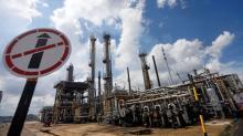 Oil falls on shock U.S. stock builds, OPEC supply worries