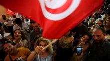 Tunisian establishment reels as outsiders claim election win