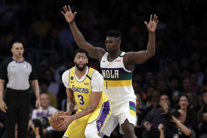Los Angeles Lakers' Anthony Davis (3) is defended by New Orleans Pelicans' Zion Williamson (1) during the second half of an NBA basketball game Tuesday, Feb. 25, 2020, in Los Angeles. (AP Photo/Marcio Jose Sanchez)