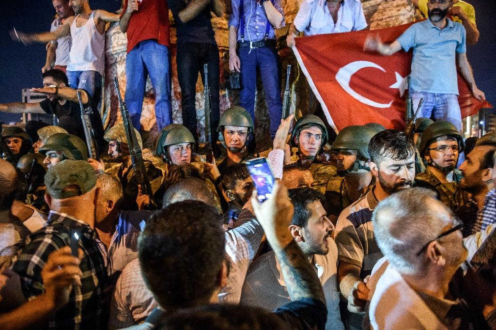 Turkish solders stand guard at Taksim Square as people protest against the military coup in Istanbul, on July 16, 2016
