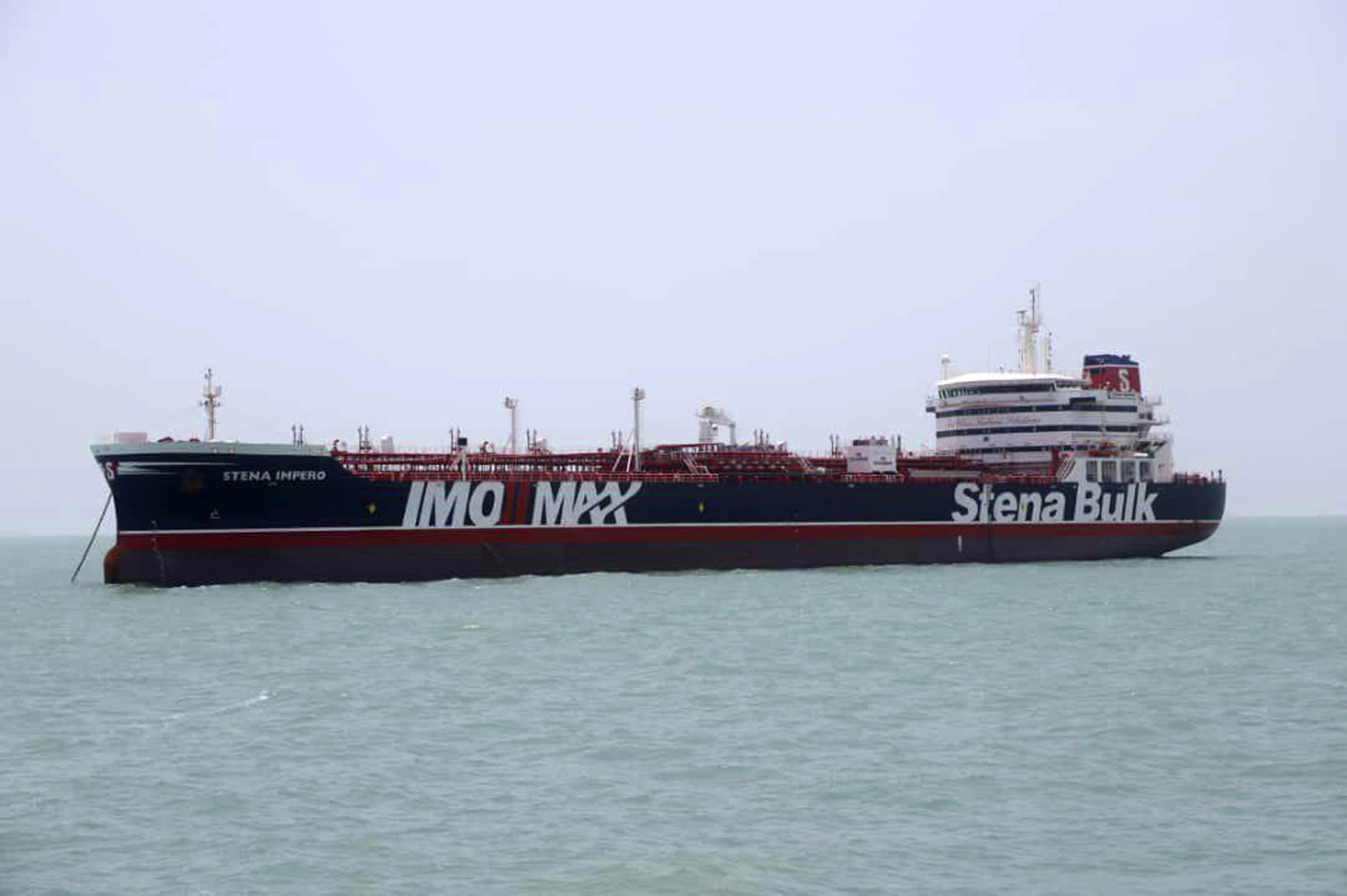 """A British-flagged oil tanker Stena Impero which was seized by the Iran's Revolutionary Guard on Friday is photographed in the Iranian port of Bandar Abbas, Saturday, July 20, 2019. The chairman of Britain's House of Commons Foreign Affairs Committee says military action to free the oil tanker seized by Iran would not be a good choice. Tom Tugendhat said Saturday it would be """"extremely unwise"""" to seek a military solution to the escalating crisis, especially because the vessel has apparently been taken to a well-protected port. (Tasnim News Agency/via AP)"""