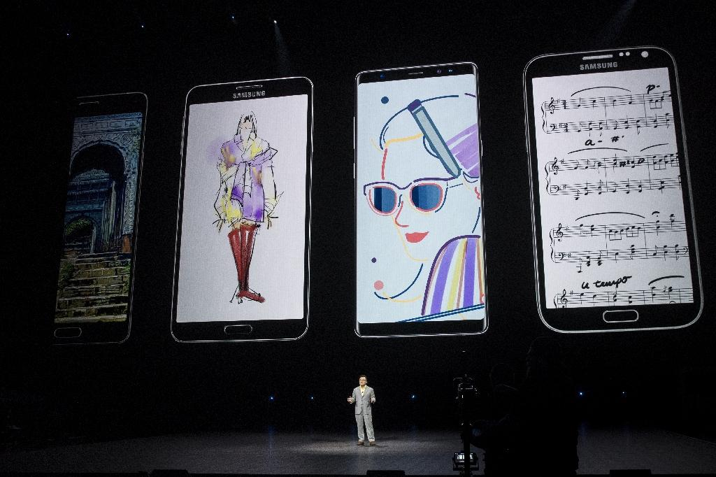 More than 1.4 billion smartphones will be sold this year, but many markets have become saturated, with consumers awaiting a new catalyst (AFP Photo/Drew Angerer)