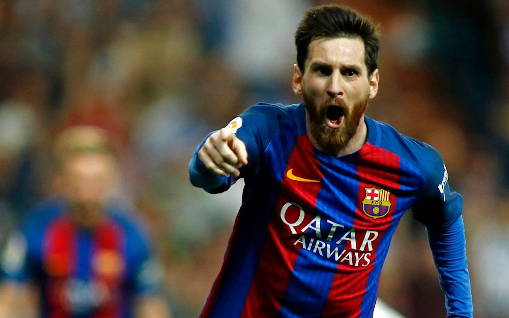 Lionel Messi celebrates his last-gasp winner for Barcelona against Real Madrid - AFP