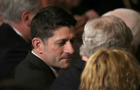 U.S. Speaker of the House Paul Ryan (L) talks with U.S. Senate Majority Leader Mitch McConnell (R) as they wait to hear U.S. President Donald Trump's announcement of his nominee for the empty associate justice seat at the U.S. Supreme Court, at the White House in Washington, D.C., U.S. January 31, 2017. REUTERS/Carlos Barria