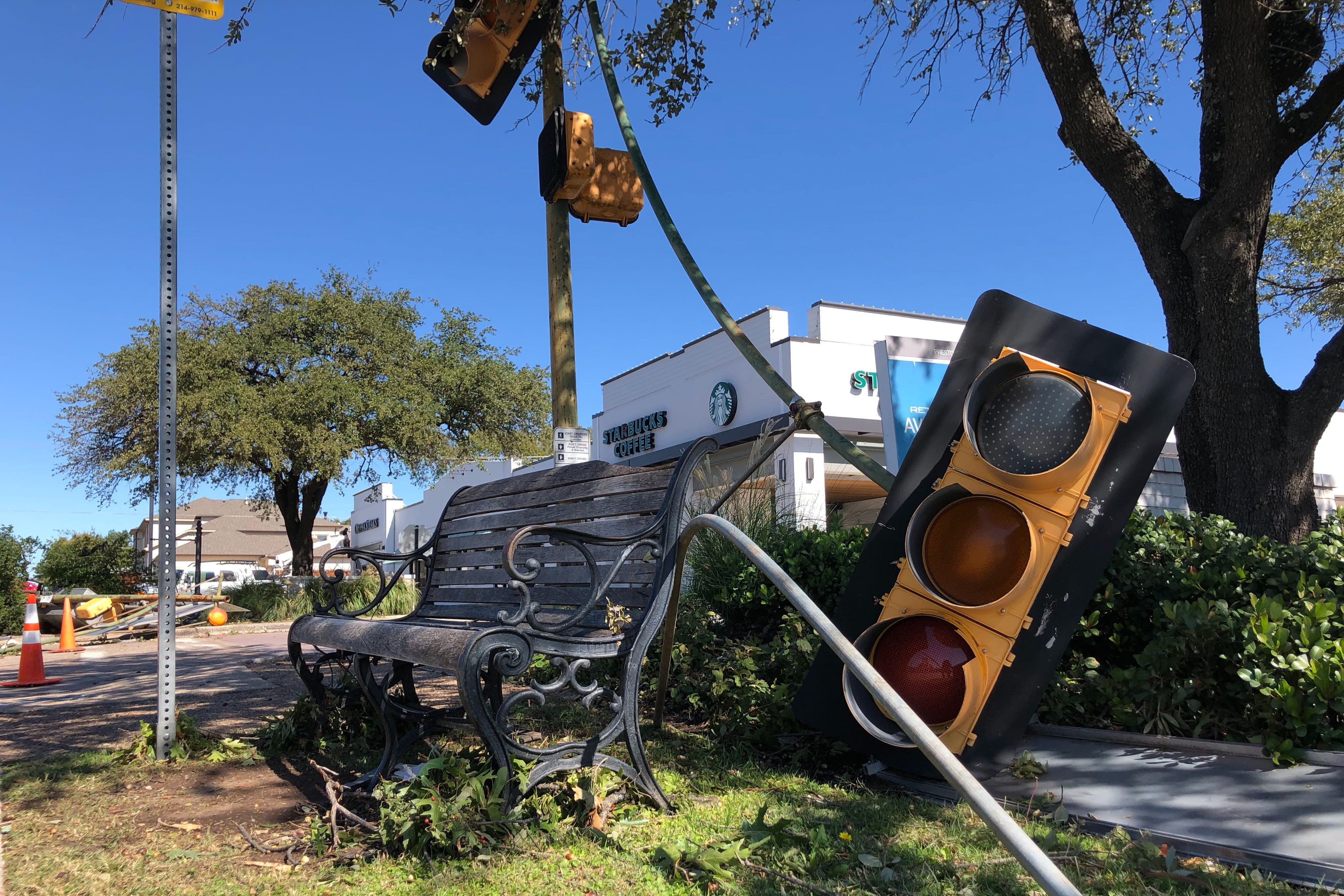 A traffic light rests at a major intersection in the Preston Hollow section of Dallas Monday, Oct. 21, 2019 after a tornado tore homes and businesses apart in a densely populated area of Dallas Sunday night. (AP Photo/Jake Bleiberg)