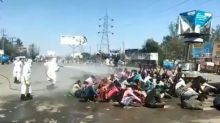 Coronavirus: Anger as migrants sprayed with disinfectant in India