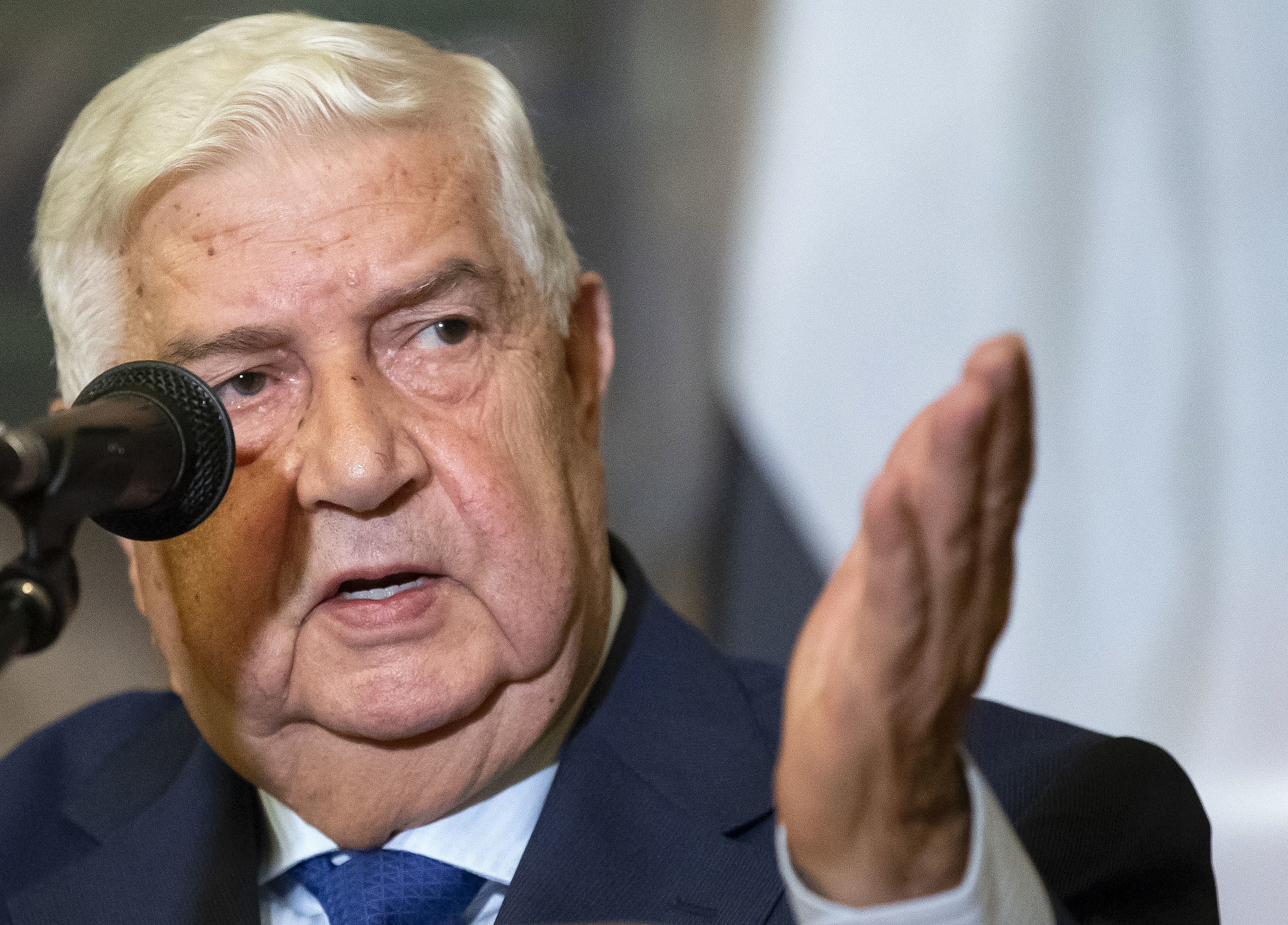 Syrian Foreign Minister Walid Muallem gestures as speaks to the media during the joint news conference with Russian Foreign Minister Sergey Lavrov, following their talks, in Moscow, Russia, Thursday, Aug. 30, 2018. Muallem's Moscow visit comes as Moscow and Damascus are increasingly worried about a possible airstrike on government positions in Syria. (AP Photo/Alexander Zemlianichenko)