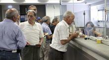 Piraeus Bank says debt plan on track as shares drop 30 percent