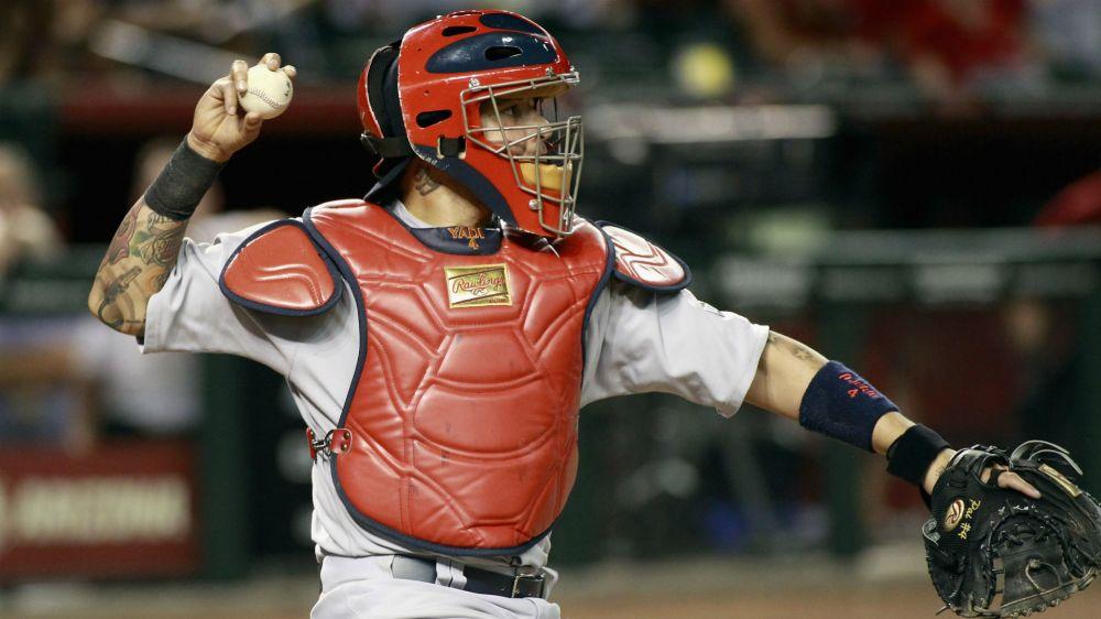 Cardinals catcher Yadier Molina somehow gets baseball stuck on him