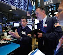 Stocks end slightly lower after China data, earnings results