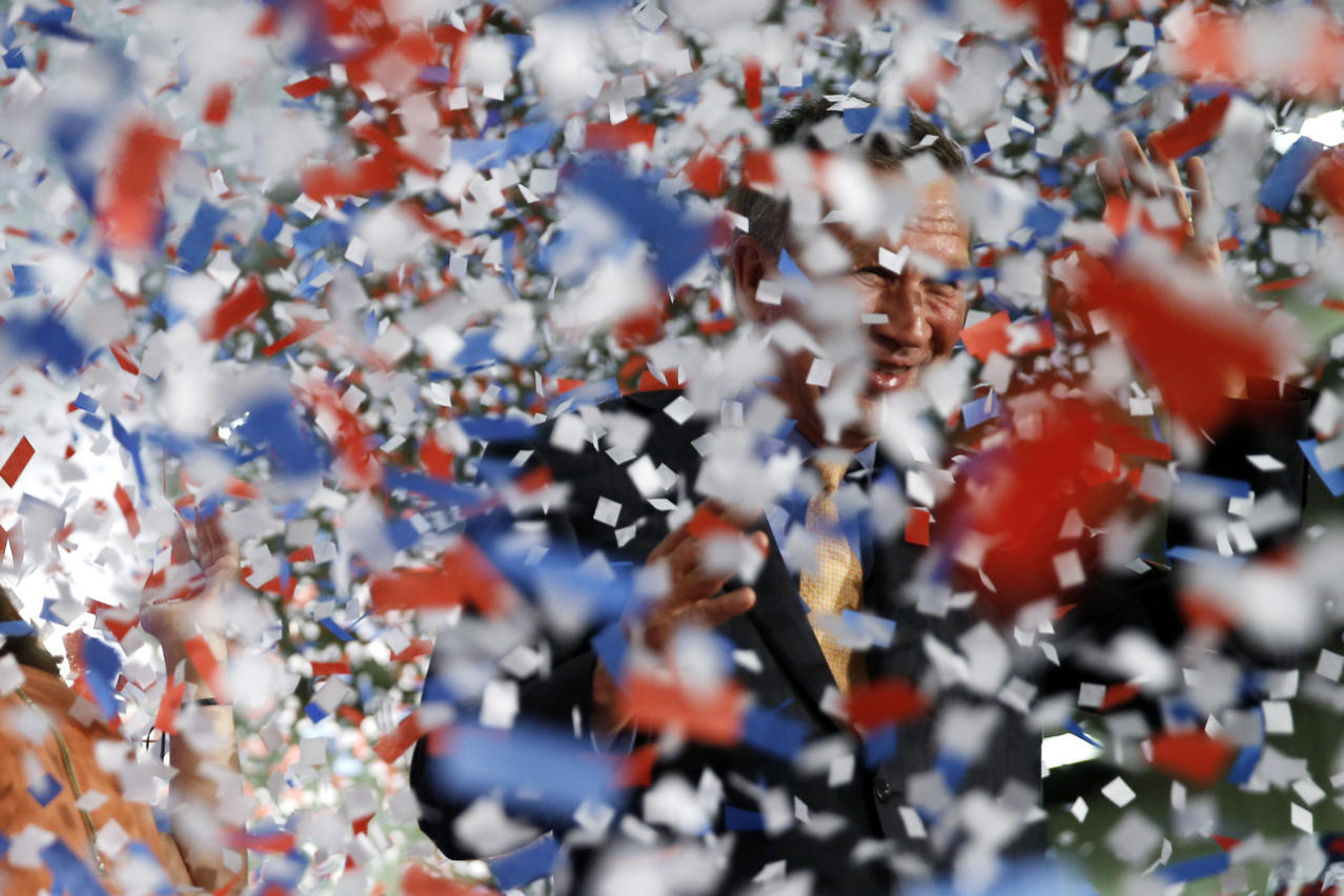 <p>An avalanche of confetti obscures Gov. John Kasich of Ohio at a rally in Berea, Ohio, as he celebrates winning his home state in the Republican primary. <i>(Photo: Matt Rourke/AP)</i></p>