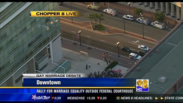 Gay marriage supporters rally downtown