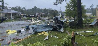 Suspected tornado destroys dozens of homes