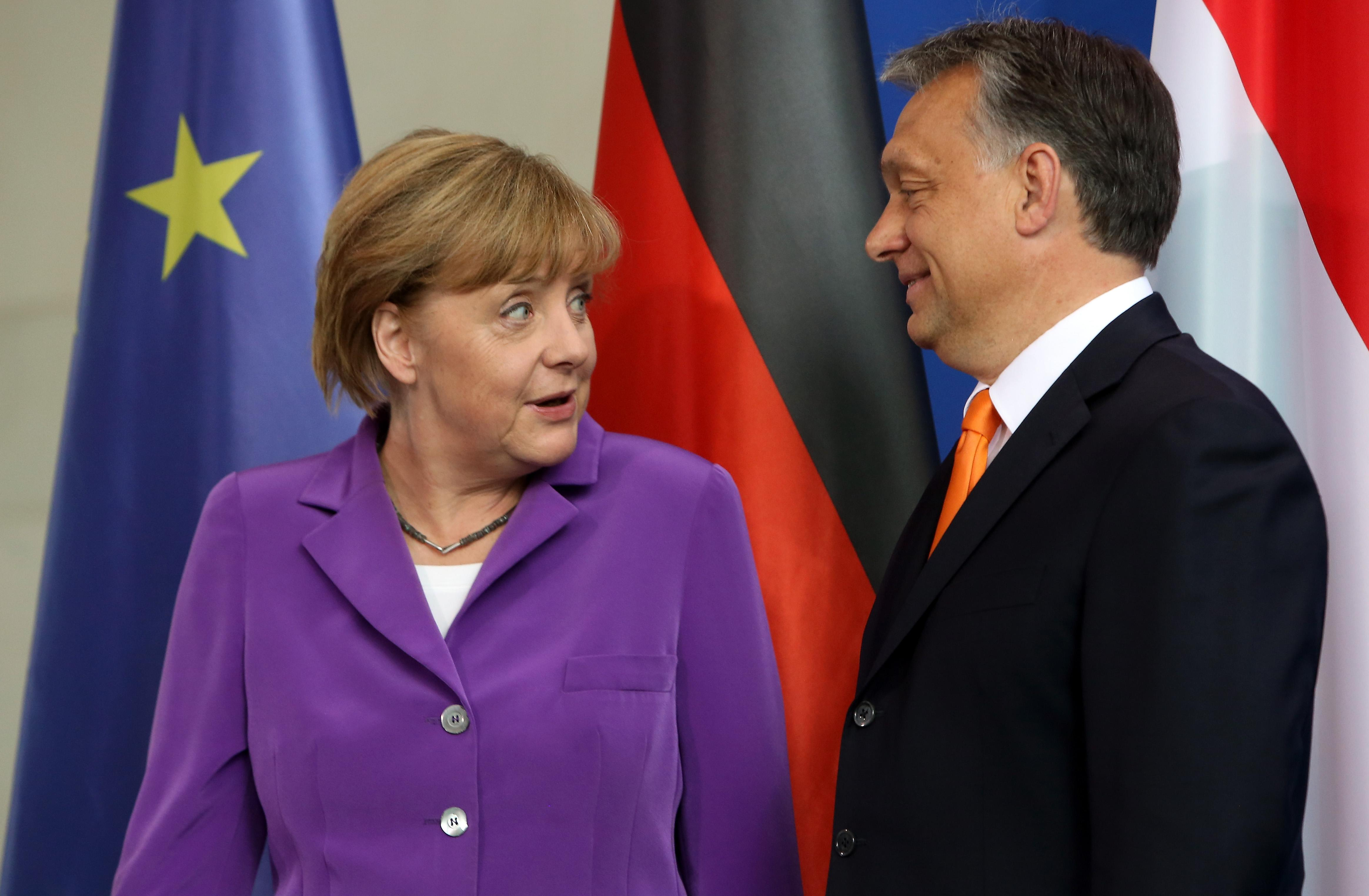 Hungarian Prime Minister Viktor Orban (R) and German Chancellor Angela Merkel meet at the German Chancellery in Berlin on May 8, 2014 (AFP Photo/Adam Berry)