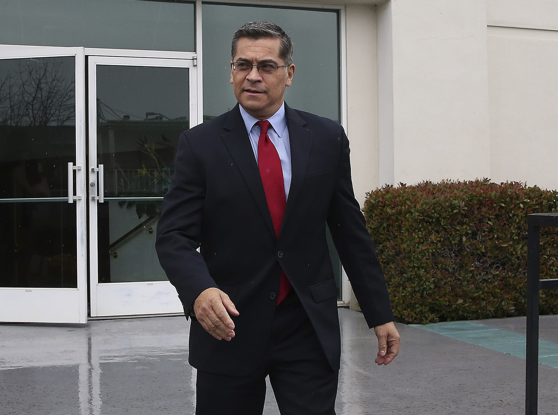 California Attorney General Xavier Becerra leaves leaves the Calvary Christian Center after meeting with SeQuette Clark, Tuesday, March 5, 2019, in Sacramento, Calif. Becerra is expected later today to announce the results of his criminal investigation into the shooting death of Clark's son, Stephon Clark, by Sacramento police officers last year. (AP Photo/Rich Pedroncelli)