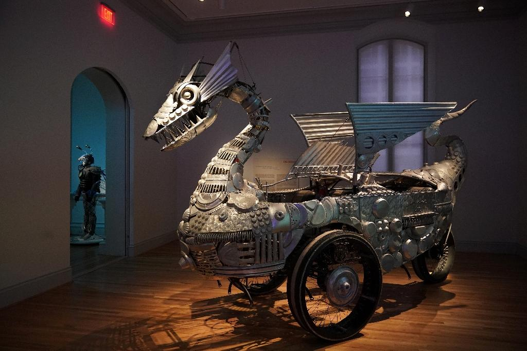 """""""Tin Pan Dragon"""" by Duane Flatmo is crafted from reclaimed aluminimum cookware (AFP Photo/Mandel NGAN)"""