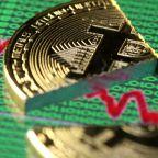 Bitcoin tanks more than 10% to start week, now back below $11,000