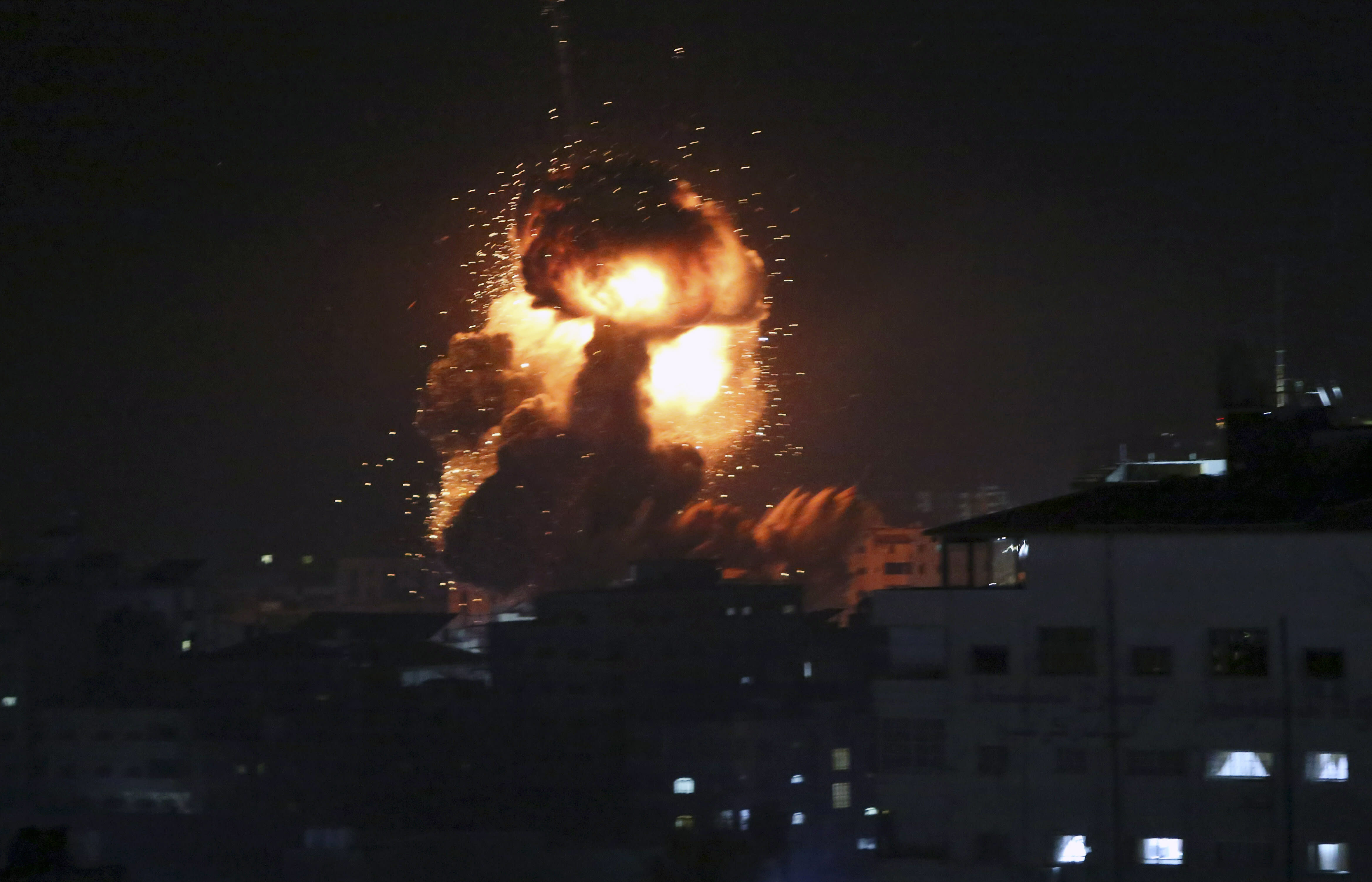 FILE - In this Monday, March 25, 2019 file photo, an explosion caused by Israeli airstrikes is seen in Gaza City. Hamas controls Gaza more tightly than ever, despite unprecedented domestic unrest and its failure to significantly weaken Israel's chokehold of the territory after a year of weekly anti-blockade rallies along their shared frontier. (AP Photo/Adel Hana, File)