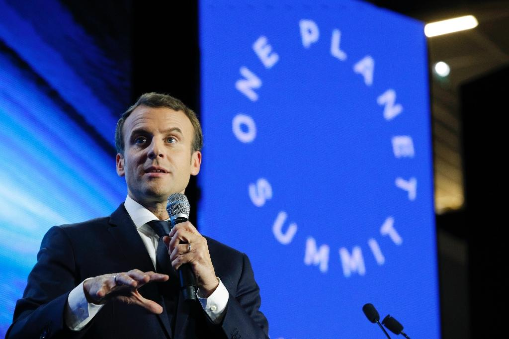 """French President Emmanuel Macron told delegates at a finance-themed climate summit in Paris """"we are not moving fast enough"""" (AFP Photo/Philippe Wojazer)"""