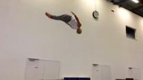 Acrobat Practices Flips in an Inspiring Workout