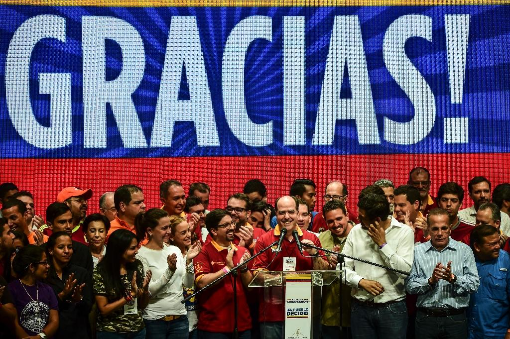 Julio Borges (C), leader of Venezuela's opposition-controlled legislature, says the vote result shows a public desire to see President Nicolas Maduro leave power before the end of his term in 2019 (AFP Photo/RONALDO SCHEMIDT)