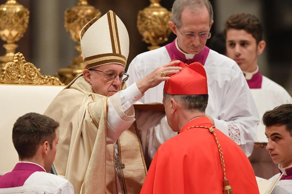 Archbishop of Chicago Blase Joseph Cupich, kneels before Pope Francis to pledge allegiance and become cardinal, on November 19, 2016 during a consistory at Peter's basilica (AFP Photo/Tiziana Fabi)