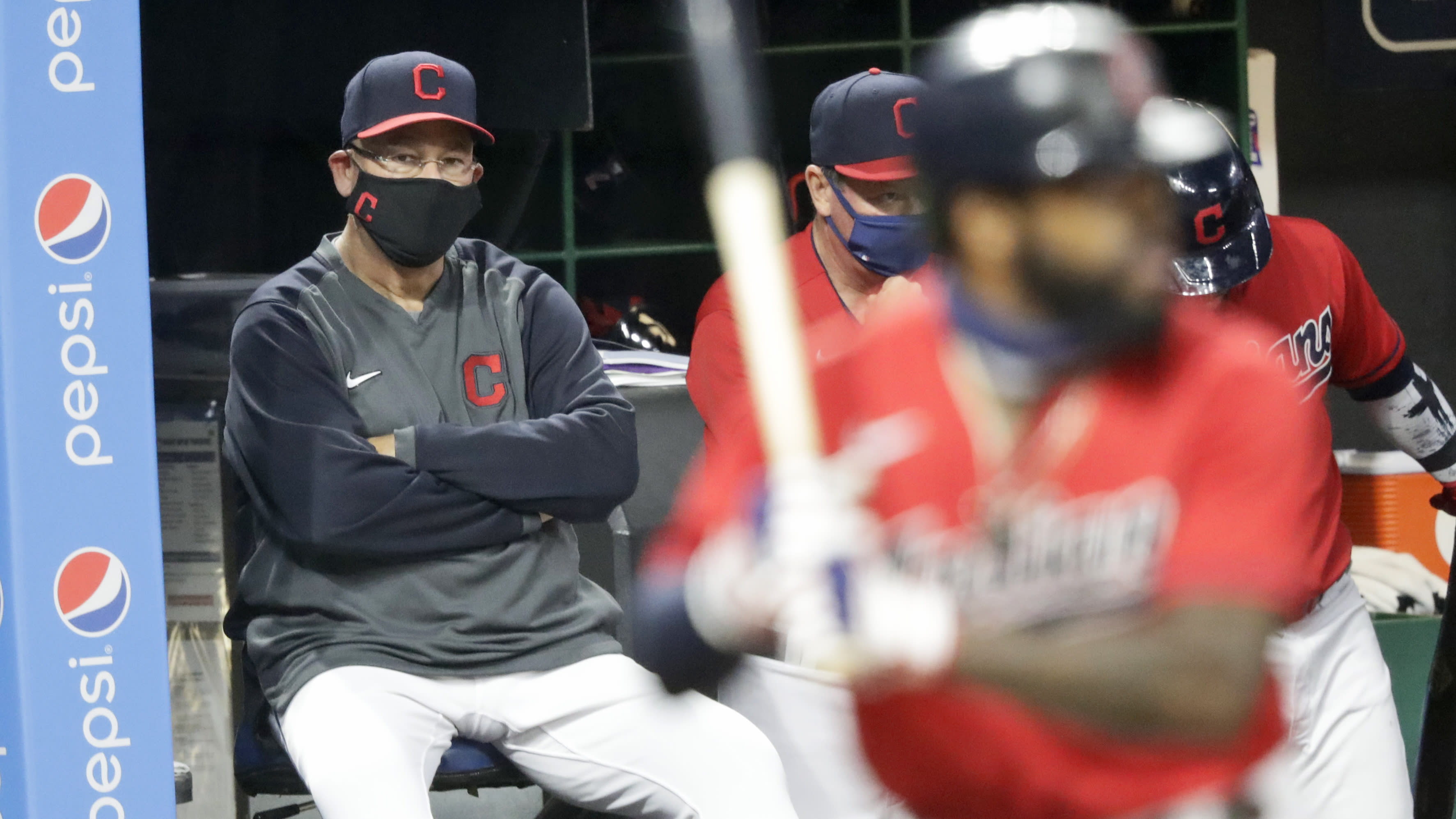 Cleveland Indians manager Terry Francona, left, watches as Cleveland Indians' Delino DeShields bats in the fifth inning in a baseball game against the Chicago Cubs, Tuesday, Aug. 11, 2020, in Cleveland. (AP Photo/Tony Dejak)