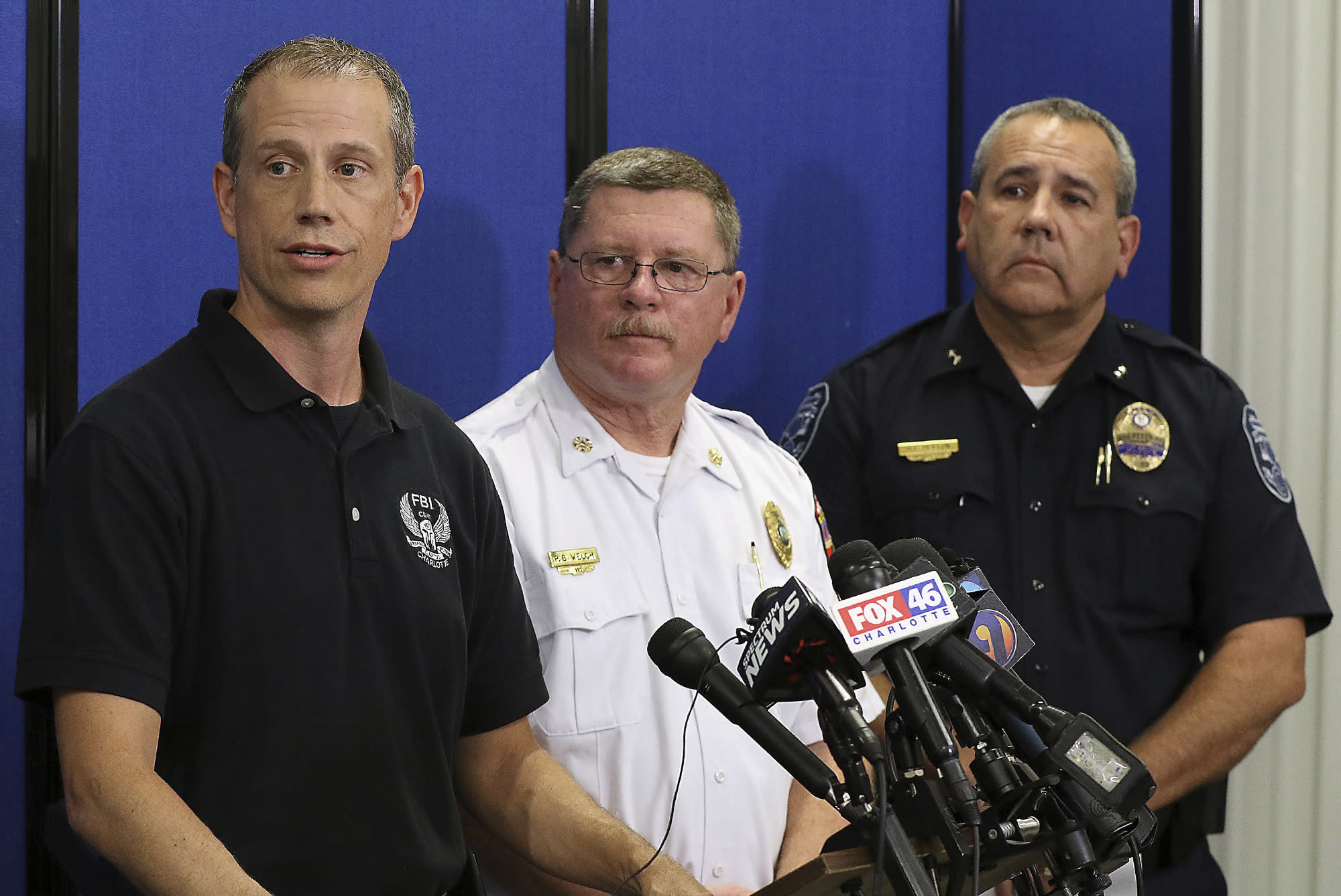 Special Agent Jason Kaplan of the FBI, Gastonia Fire Chief Phil Welch, and Gastonia Police Chief Robert Helton, answer questions during a press conference Tuesday September 25, 2018, in Gastonia, N.C. to give updates on the search for six-year-old Maddox Ritch who went missing September 22 from Rankin Lake Park in Gastonia. (John Clark/The Gaston Gazette via AP)